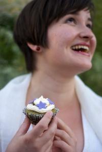 Elisabeth and a cupcake.