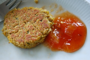 Tofu and red lentil burger served with mango chutney.